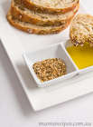 Dukkah Recipe with dukkah and olive oil and some rye bread on a white plate