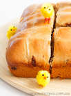 Hot Cross Buns on a wooden board with yellow toy chickens
