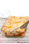 Baked lasagna in glass baking dish