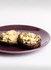 party appetiser of stuffed mushrooms on a brown plate