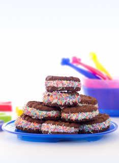 Chocolate Sandwiches  with marshmallows and sprinkles on a blue plate