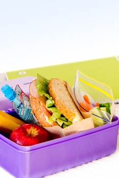 School lunch box with fresh fruits, toast and yogurt